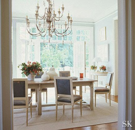open airy white dining room with wood floor traditional design