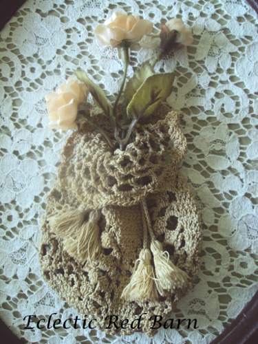Vintage crocheted purse with silk flowers