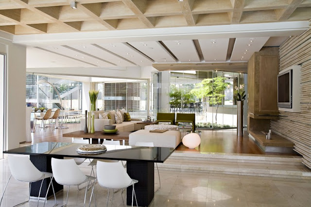 Photo of elevated living room with dinning table in front
