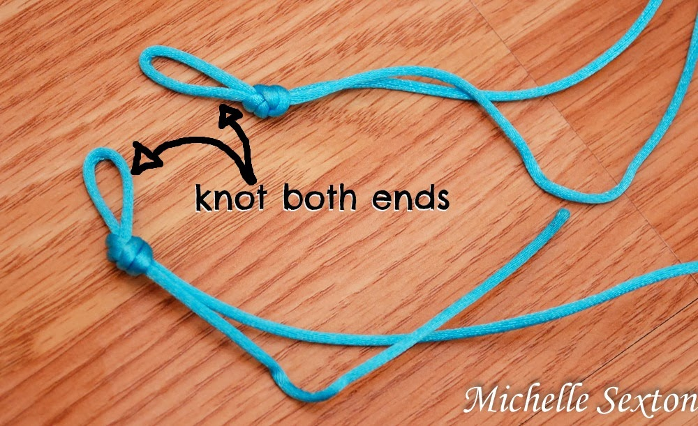 fold over and tie a knot to form a loop on each end.