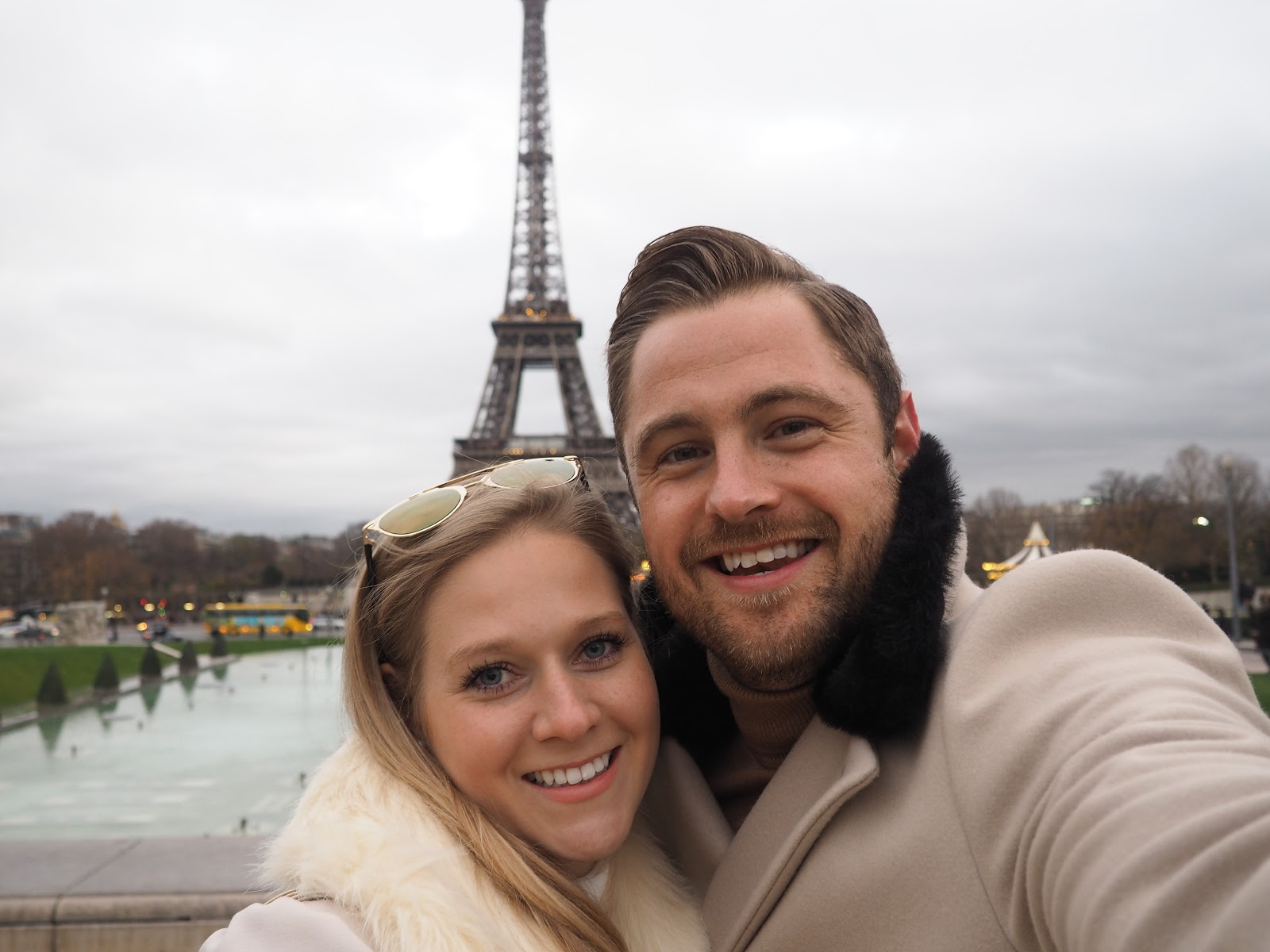 Couple standing outside the Eiffel Tower, Paris