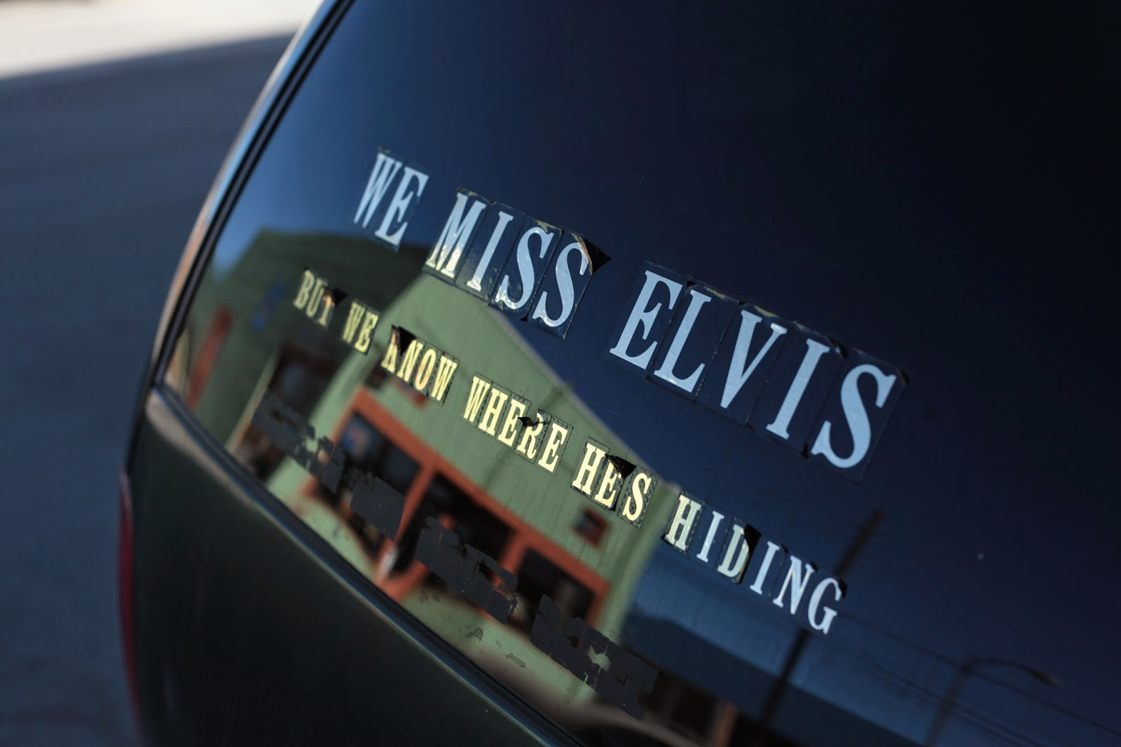 "A bumper sticker in Salida, CO that says, ""We Miss Elvis But We Know Where He Is""."