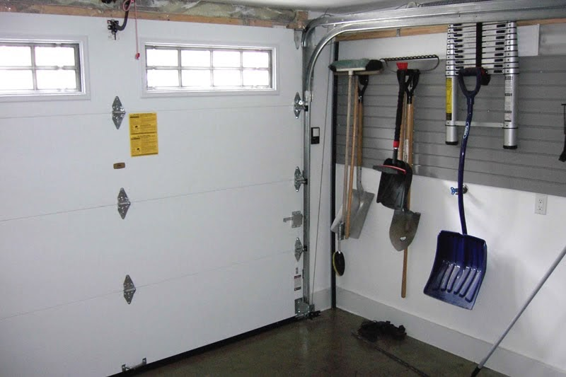 Portes fen tres solariums v randas et puits de lumi re for Porte de garage installation