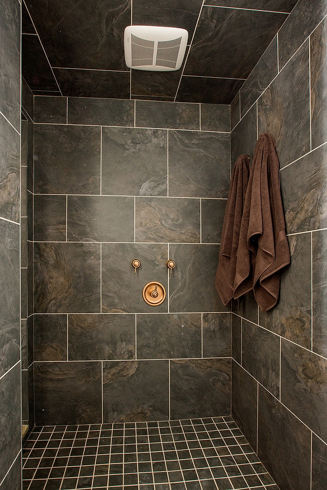 Dark shower cabin in Craftsman style home in Dublin, Ohio
