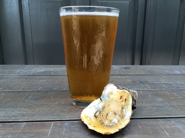 A pint of Gnarly Barley Brewing's Catahoula Common with a chargrilled oyster at Jolie Pearl Oyster Bar in Baton Rouge