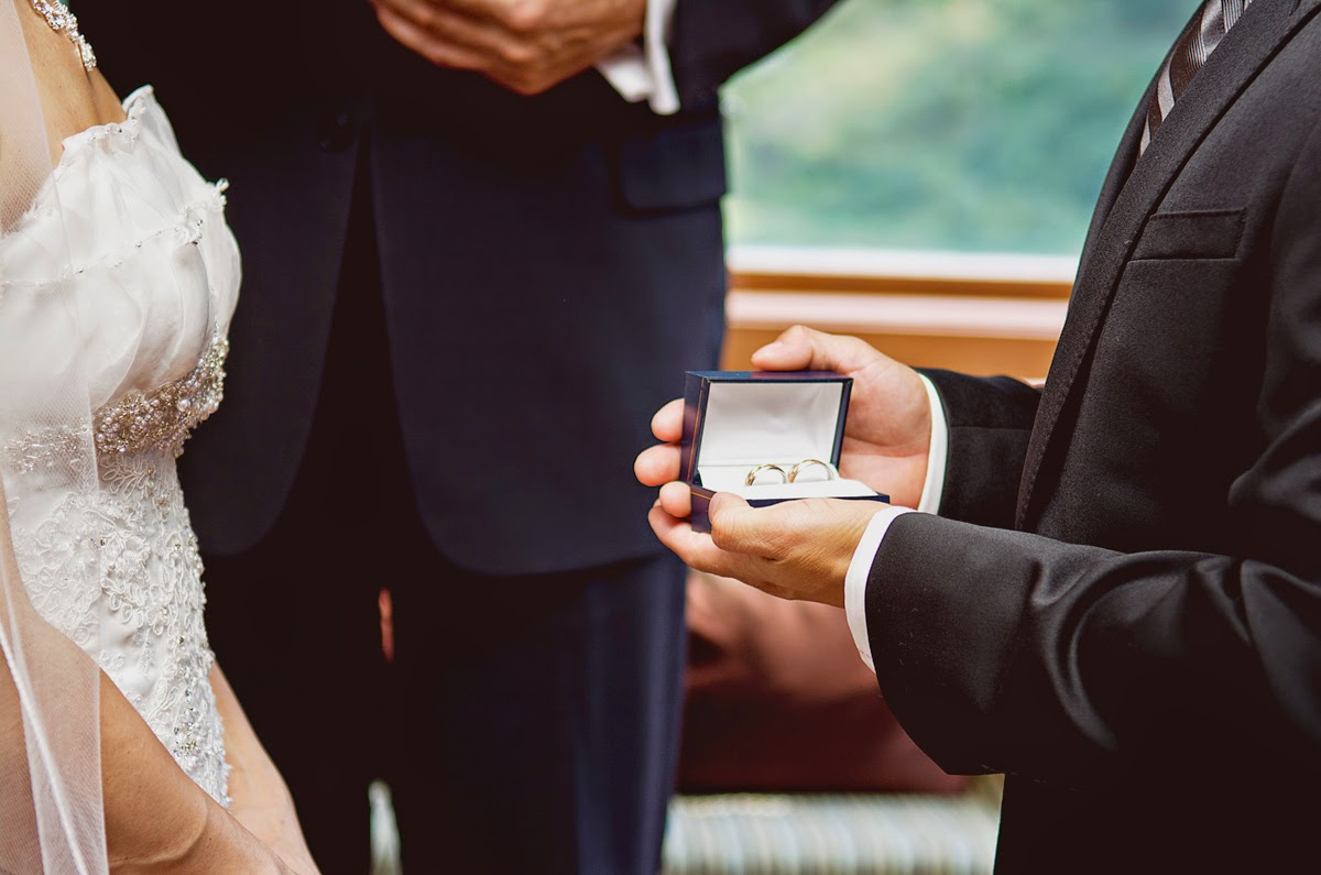 Time for Miki and Luis to exchange wedding rings - Kent Buttars, Seattle Wedding Officiant
