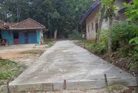 Desa  Koto Iman  Bangun Jalan Lingkungan dan Drainase