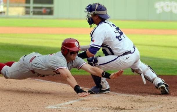 Oklahoma University's Mac James, front dives towards home plate as TCU catcher Kyle Bacak makes the tag for the out during the first inning of Friday's May 9, 2014 baseball game at Lupton Stadium in Fort Worth, Texas. Special/Bob Haynes