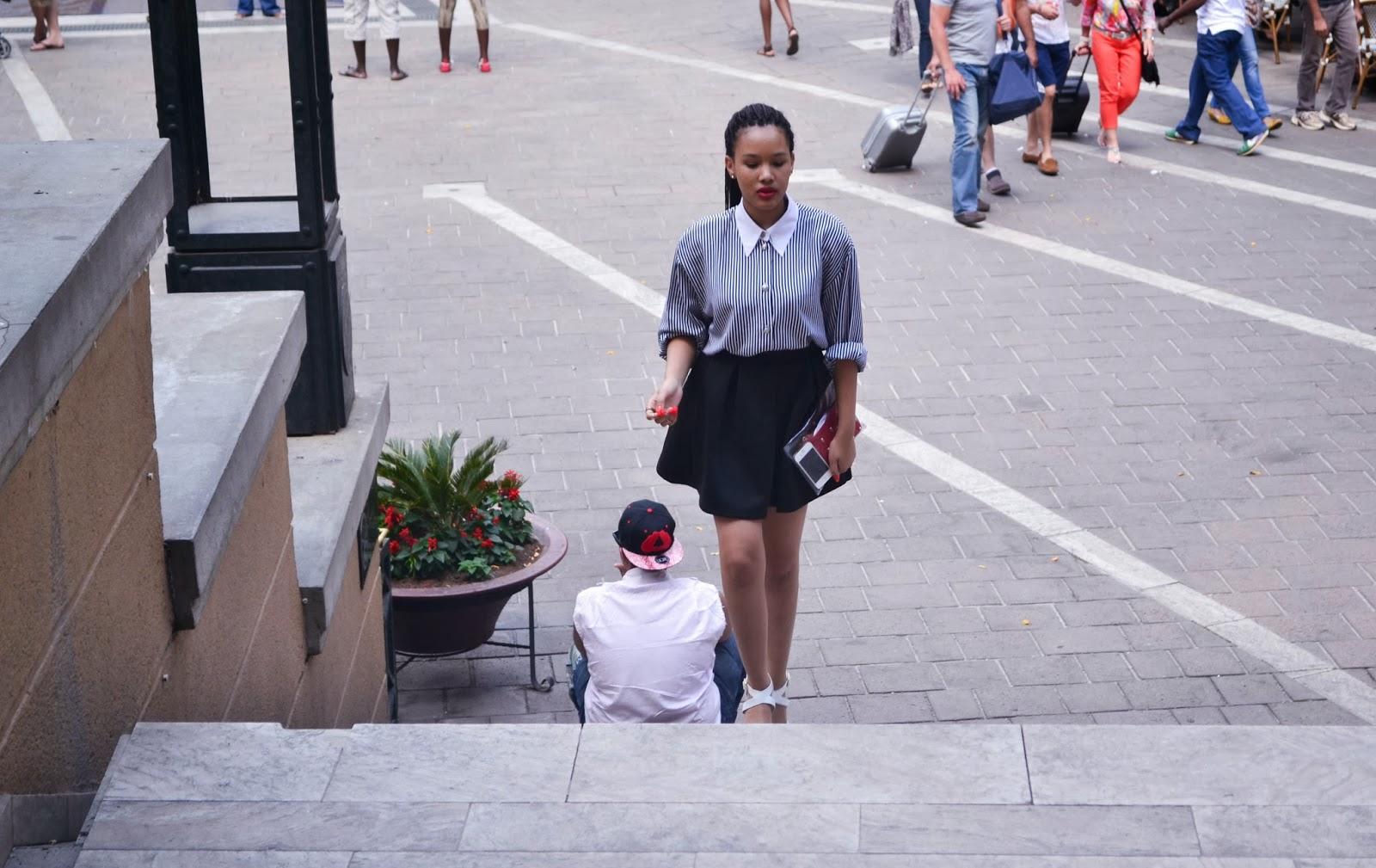girl walking up steps nelson mandela square