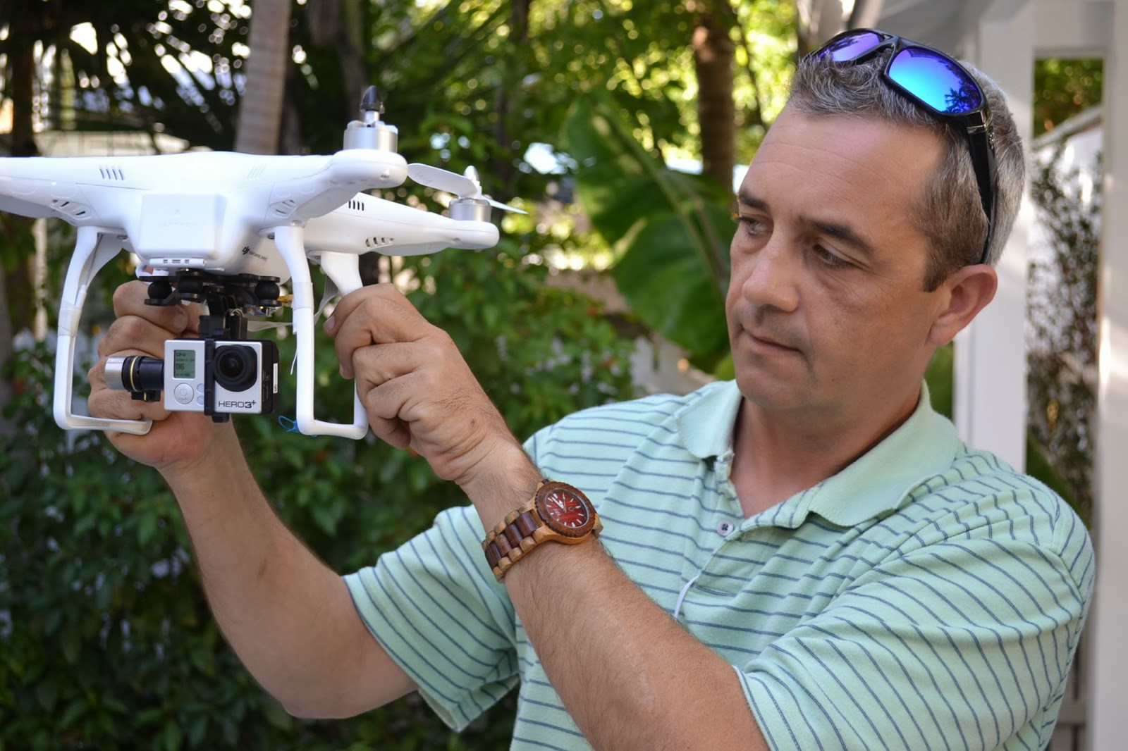 Grant Roland shows off his drone that will shoot the property at 405 Olivia Street in Key West