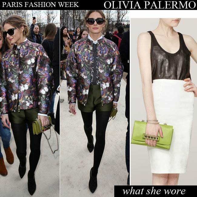 Olivia Palermo in floral bomber jacket, green shorts, green clutch with black ankle boots Want Her Style