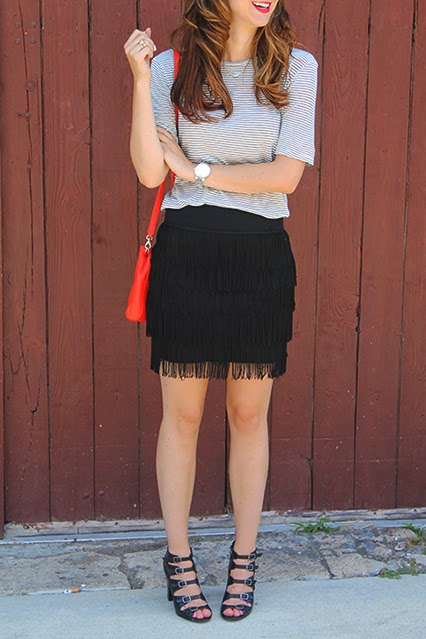fringe skirt, tassel skirt, flapper skirt, emerson and grace, wetherly tshirt, blue and white striped shirt, kate spade red bag, cobble hill crossbody, red kate spade crossbody, buckle strappy heels, marc jacobs sunglasses