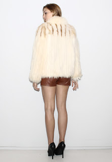 Vintage 1970's white fox fur coat with brown stripe detail at the top.