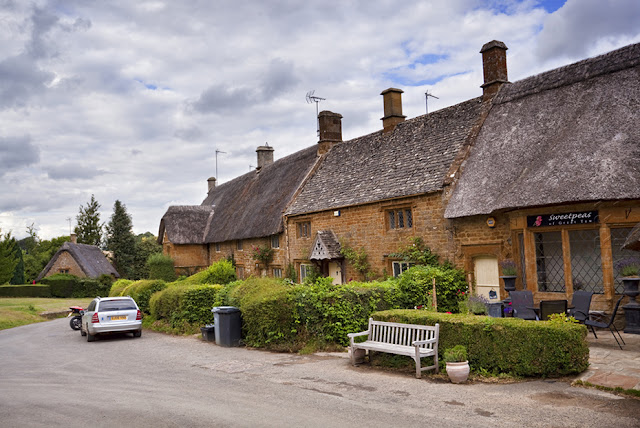 Iron Stone thatched cottages in the village of Great Tew by  Martyn Ferry Photography