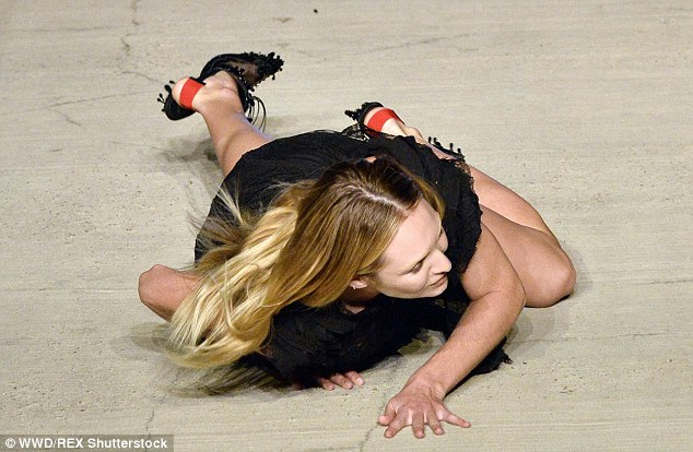 Candice Swanepoel takes a fall down the Givenchy SS16 NYFW Runway