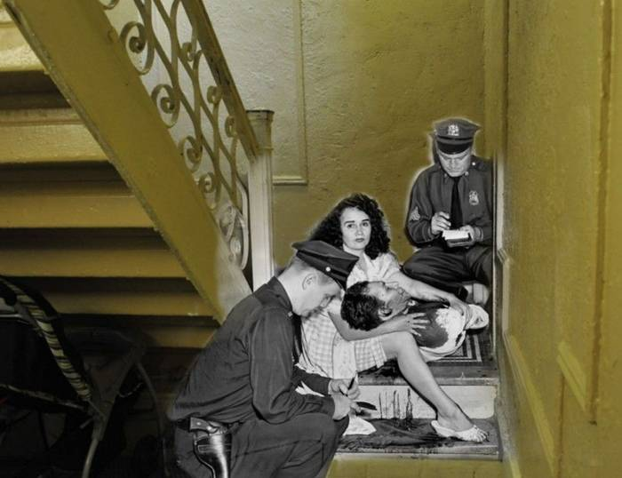 September 25, 1961. Josephine Deksidor keeps bleeding Lenaresa James, who was gunned down by her jealous husband on the stairs of a residential building in the Bronx.