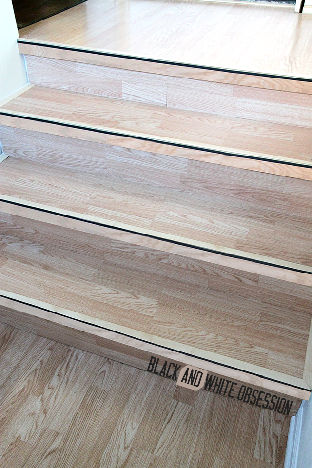 Frame the steps using T-moldings | Installing New Tarkett Plank Flooring in our Entryway | www.blackandwhiteobsession.com