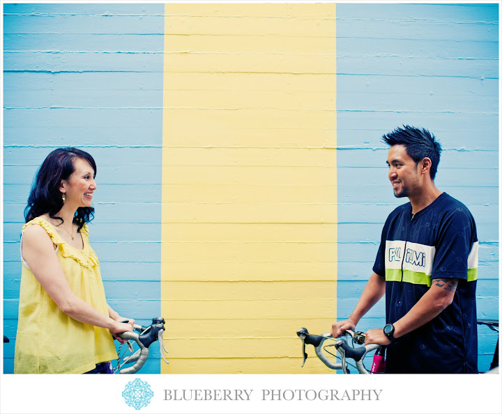 San Francisco hip urban engagement photography with blue yellow graffiti and bikes