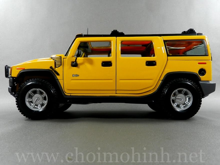 Hummer H2 SUV 1:18 Maisto yellow side