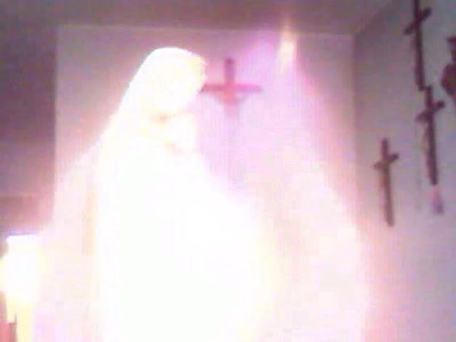 Virgin Mary Apparition: Ghostly Figure Appears In Camera