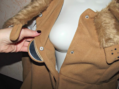 http://www.fashionmia.com/Products/lapel-fur-collar-plain-overcoats-114456.html