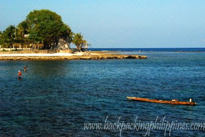 Ilocos sur here you can find locals taking a swim and using a bamboo