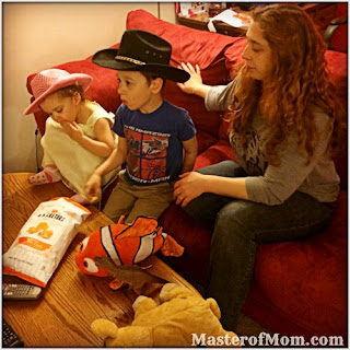 themed movie nights, watching movies with kids, kid movies, eating popcorn, fun family activities