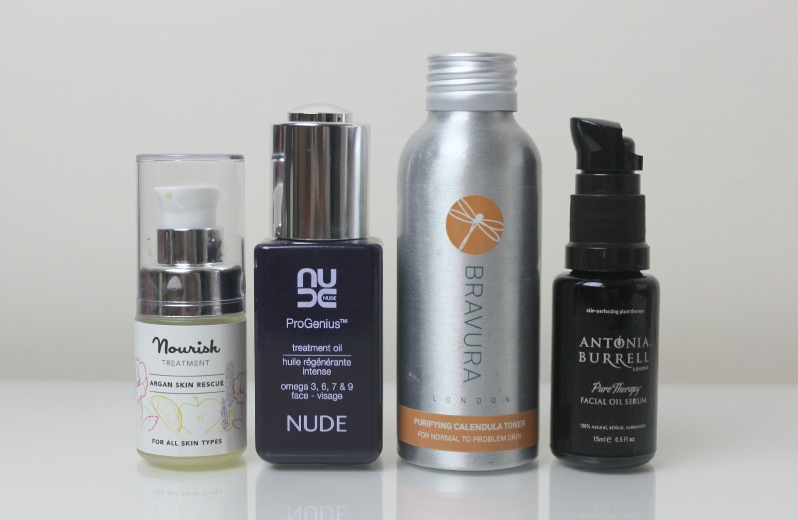 A picture of Nourish Argan Skin Rescue, Nude ProGenuis Treatment Oil, Bravura Purifying Calendula Toner and Antonia Burrell Pure Therapy Facial Oil Serum