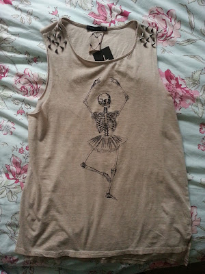 A picture of a skeleton ballerina spiked top