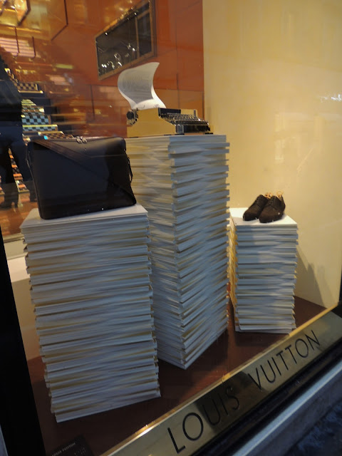Stacks of paper in menswear visual merchandising display in Rome