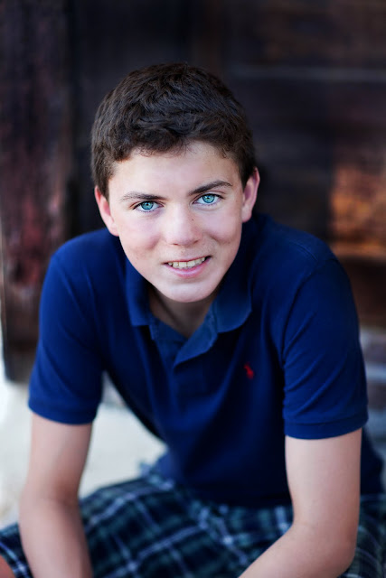 Class of 2012 Senior looks up at camera with gorgeous blue eyes during his Tucson portrait Session