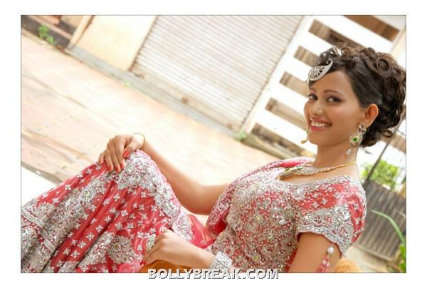 Sanjana singh sitting down in traditional red dress - (4) -  Sanjana singh new photo shoot
