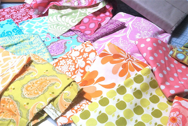 pink, orange, lime, aqua, lavender and red quilting fabric