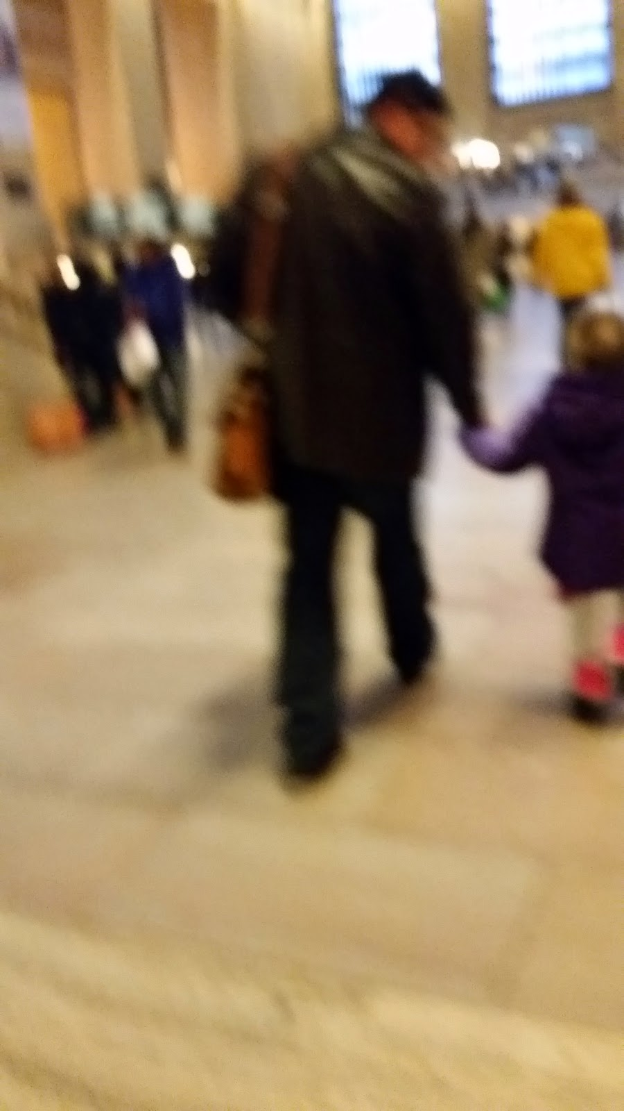 4 year old with dad in grand central station