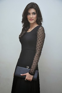 Kriti Sanon Picture Gallery in Black Dress at 1 Nenokkadine Movie Audio Launch Function ~ Celebs Next