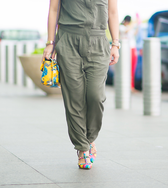 Crystal Phuong head to the airport in a green jumpsuit and heels.