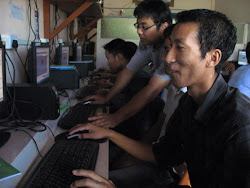 Students learning how to do 3D modeling with help from Oyimpong Imchen