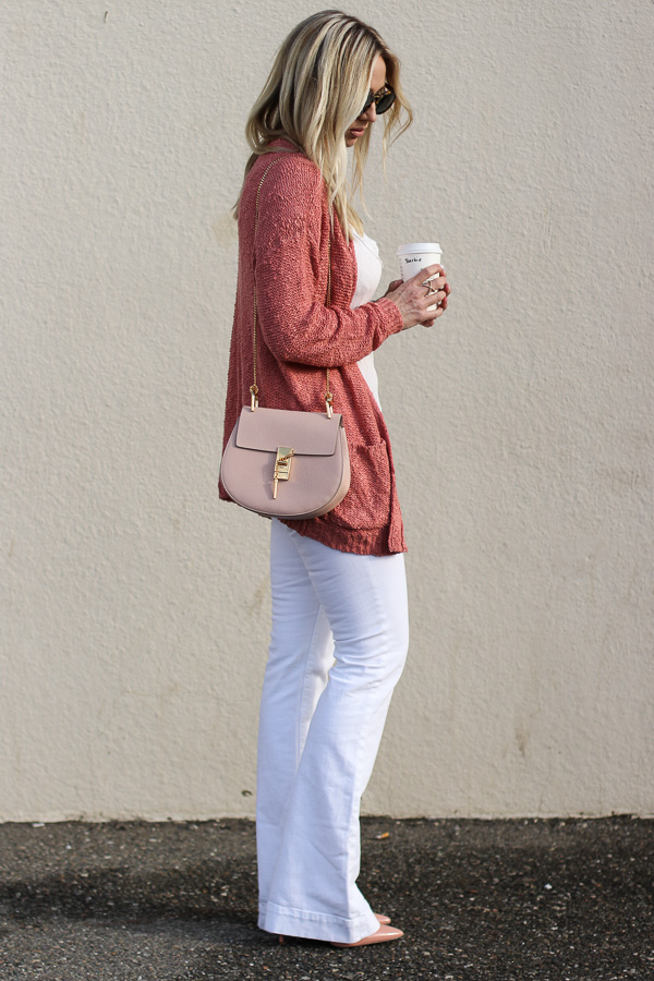 rust sweater white flare denim heels blush chloe cross body