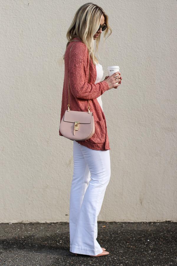 rust sweater white flare denim heels blush chloe cross body