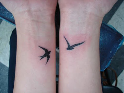 Silhouette Swallow Tattoo