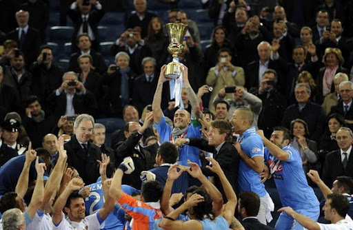 Napoli captain Paolo Cannavaro lifts the trophy after winning the Coppa Italia