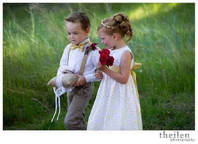 Adorable ring bearer and flower girl in gold l Theilen Photo l Take the Cake Event Planning
