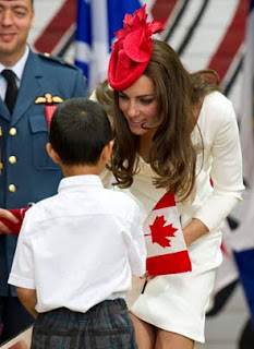Kate, Duchess of Cambridge, greets a young newly sworn in Canadian citizen during a citizenship ceremony on Friday, July 1, 2011, in Gatineau, Canada.