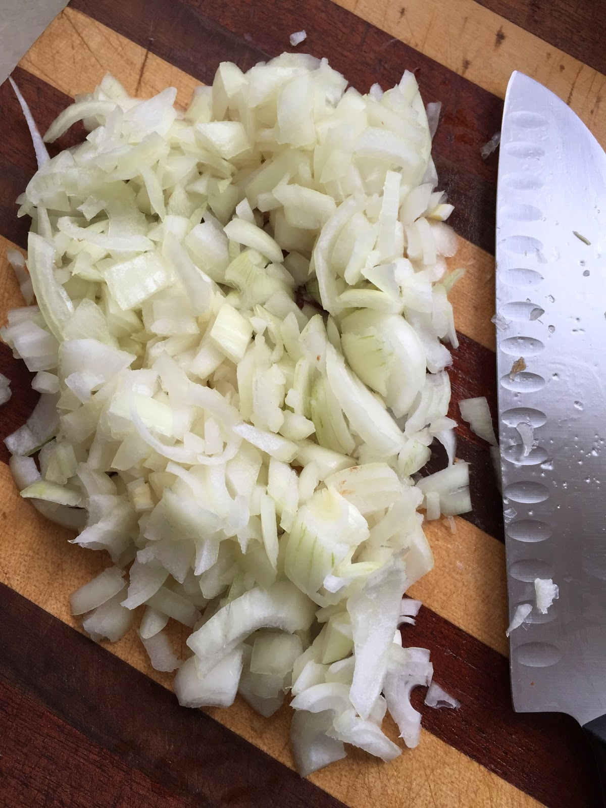 Chopped Onions on a Cutting Board with Knife Veega Blog