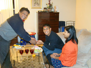 SGT Saral Shrestha and his wife Elisha celebrate the Soldier of the Year victory with his uncle, Purushottam Kuthu.