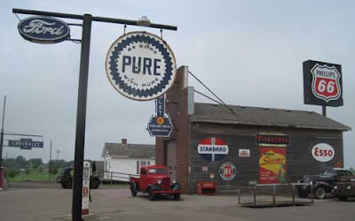 Pure gas sign and other old gasoline signs on an old gas station