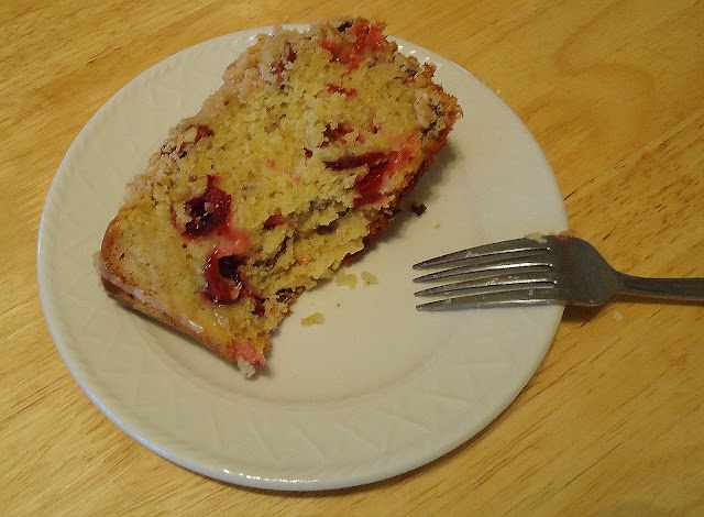 This Cranberry Orange Coffee Cake is a moist crumb cake that will brighten up any cold winter night! Get the quick and easy coffee cake recipe from BlahnikBaker.com