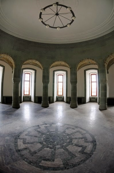 Wewelsburg Castle's Hall of the Supreme SS Leaders, with the neo-pagan symbol of a Black Sun set into the marble floor