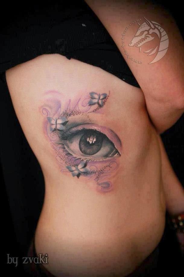 tattoo feminina olho em 3d na costela