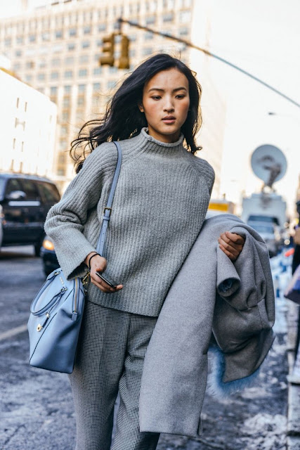 Lovely all grey outfit for fall grey turtleneck sweater grey dress pants and a pastel blue bag